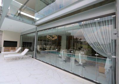 124-Frameless-Glass-Folding-Stackable-Doors-1024x683-1