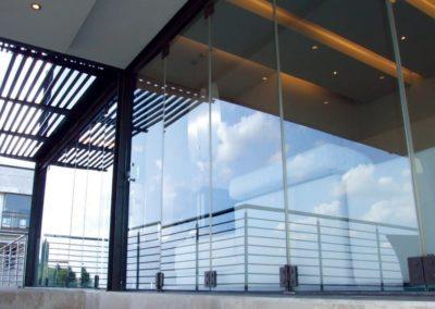 125-Frameless-Glass-Folding-Stackable-Doors-1024x683-2